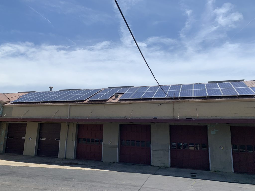 Our eco-friendly pest control solar panels on Gunter's vehicle fleet garage building.