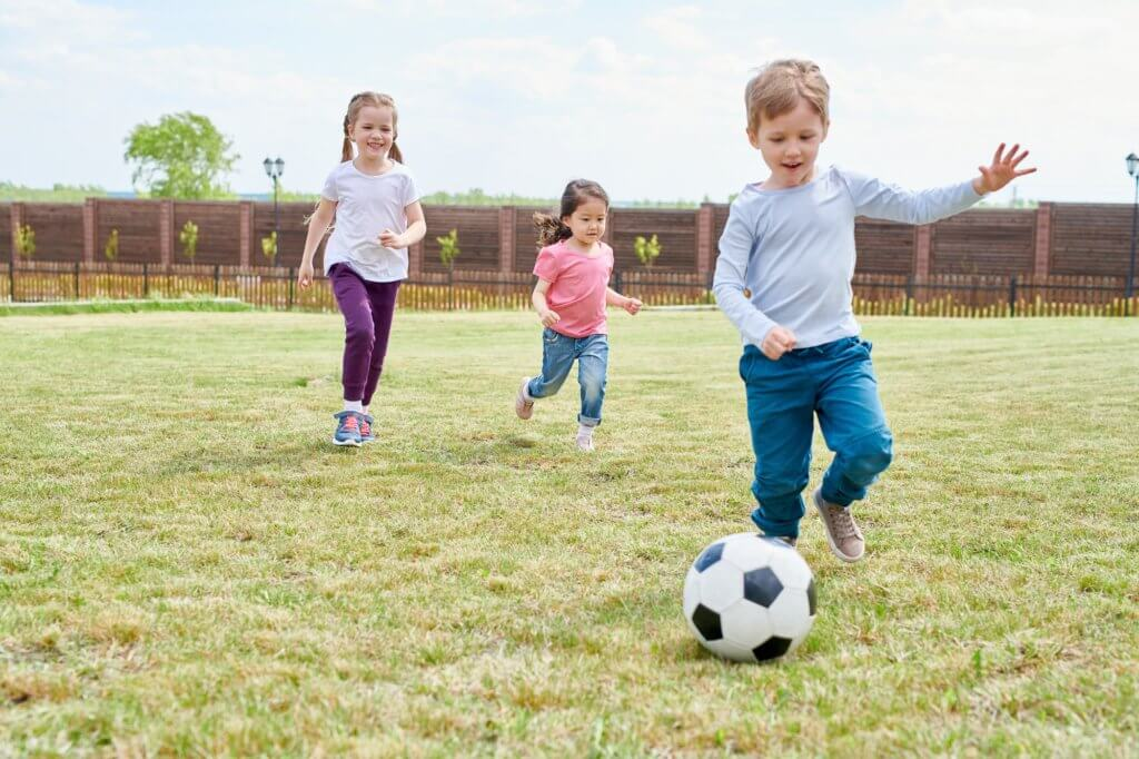 Kids playing outside and incorporating exercise.