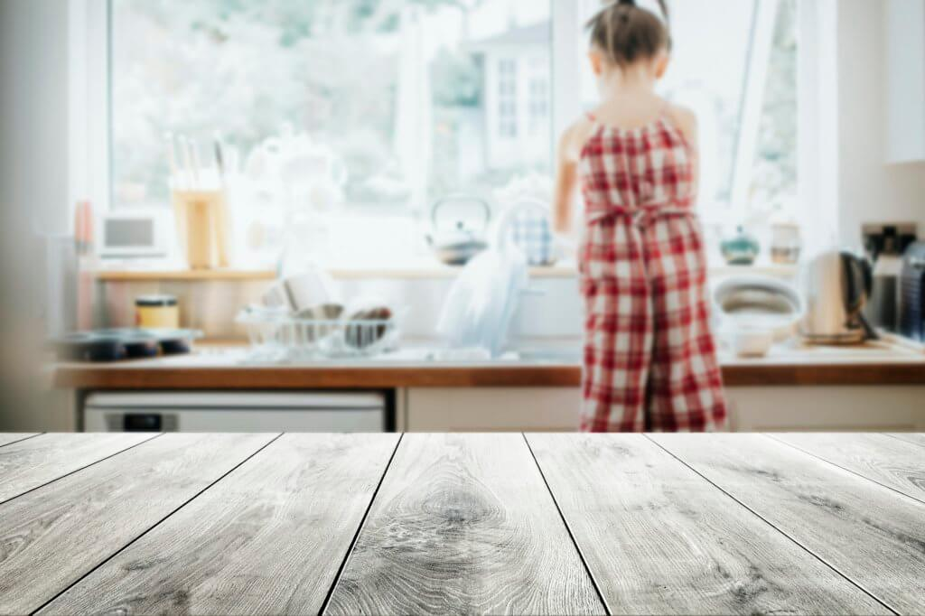 Focus On High-Risk Areas. Wooden Kitchen Table.